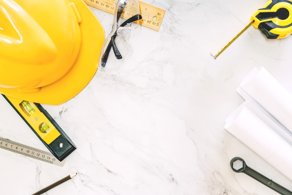 construction-tools-with-helmet-safety-on-white-marble-background_t20_XxxEl3