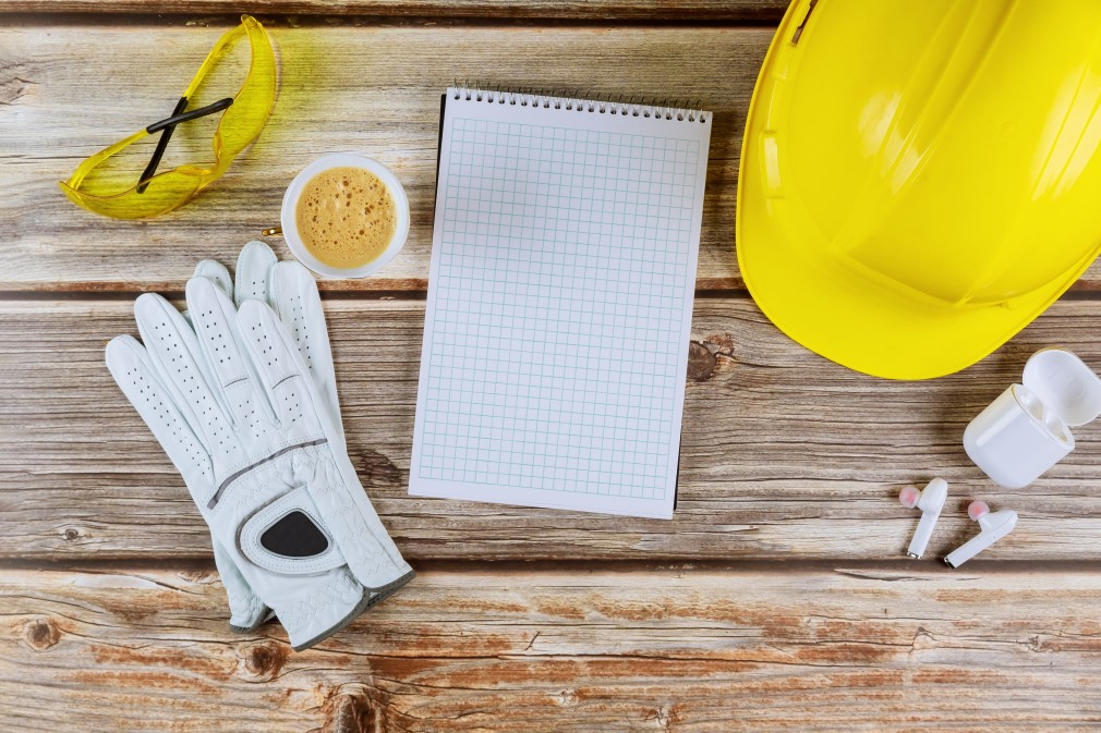 safety-helmets-glasses-for-workplace-office-table-construction-with-notebook-cup-of-coffee-wireless_t20_P1zBNQ
